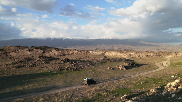 landrover defender driving in front of mountain landscape of eastern anatolia - anatolia stock videos and b-roll footage