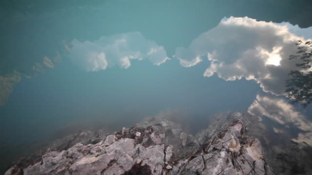 landscape and nature surrounding lago di sorapiss lake in italy. - goodsportvideo stock videos and b-roll footage