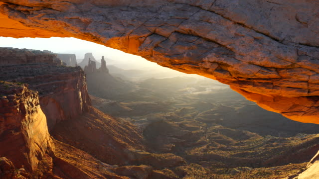 landscape arch at sunrise, canyonlands national park, utah, usa, north america, america - canyonlands national park stock videos & royalty-free footage