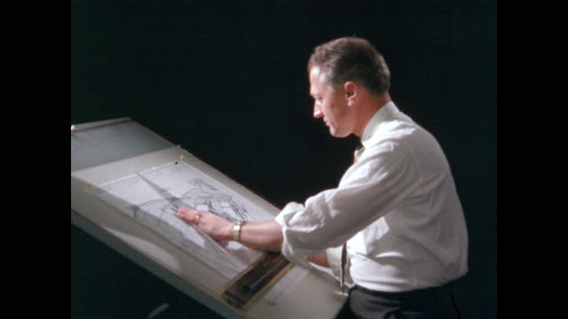 landscape architect works at drafting table - 製図板点の映像素材/bロール