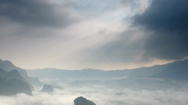 landscape footage of mist flowing with mountain and sun ray at phu langka when sunrise time - langkawi stock videos and b-roll footage