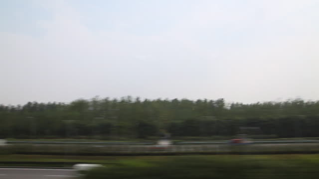 WS POV Landscape from moving train window / Pudong, Shanghai, China