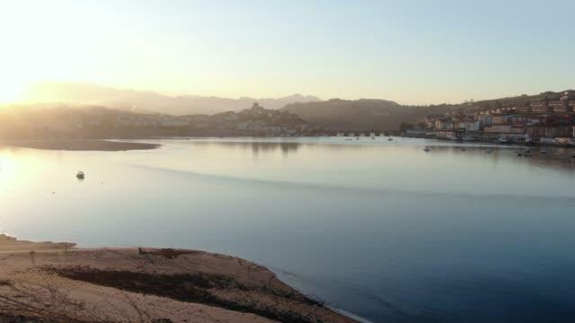 vídeos de stock e filmes b-roll de landscape in cantabria, spain, at sunset. st. vincent de la barquera - cidade pequena