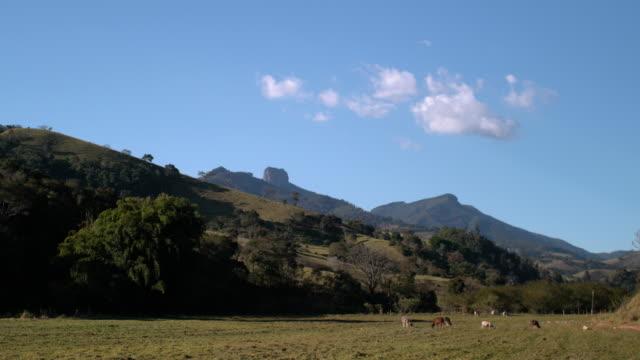 vídeos de stock, filmes e b-roll de landscape in mantiqueira mountains with bau rock on the background - mountain range