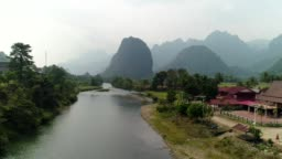 Landscape Mountain of Vang Vieng village with limestone mountains, Laos