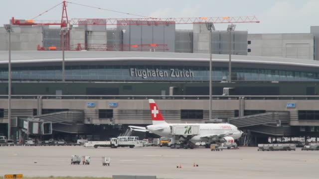ws landscape of airport / zurich, switzerland - airport terminal stock videos & royalty-free footage