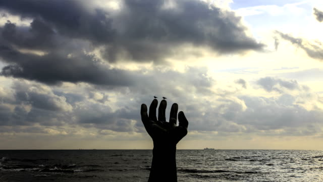 Landscape of bronze sculpture shaped like a pair of hands (Called Sangsaeng¡¯s Hand and constructed in 2004) (Popular tourist destinations) and seascape in the sunbeam in Homigot, Pohang