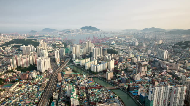 landscape of busan harbor and a large bridge from munhyeondong - cloud computing stock videos & royalty-free footage