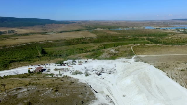 AERIAL: Landscape of farmlands and open stone quarries