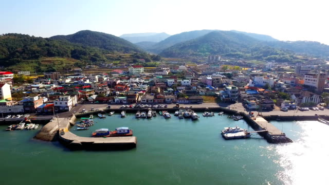 landscape of fishing village in jijokhang harbor - fishing village stock videos and b-roll footage