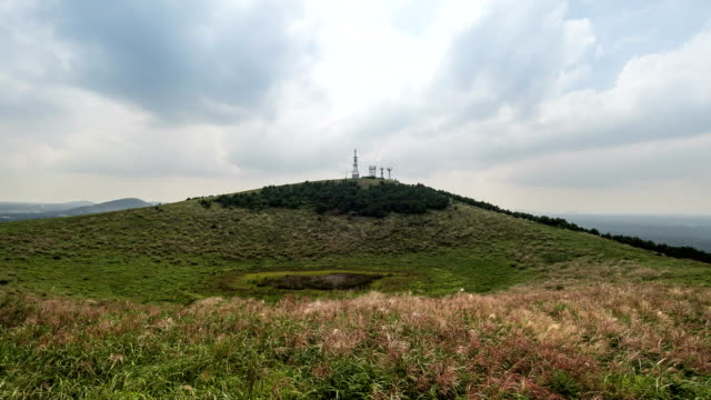 landscape of geumoreum volcanic cone - cloud computing stock videos & royalty-free footage