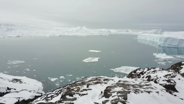 landscape of glacier and icebergs in ilulissat, greenland - ice sheet stock videos & royalty-free footage