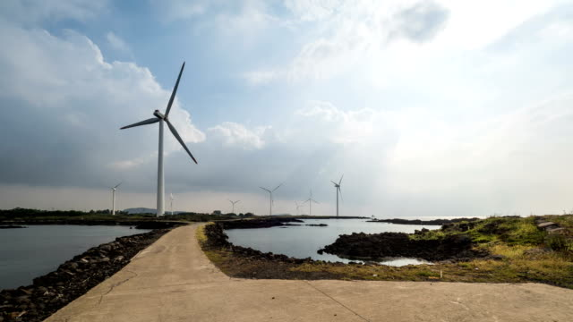 Landscape of many Vertical axis wind turbine at wind power station near coastal feature