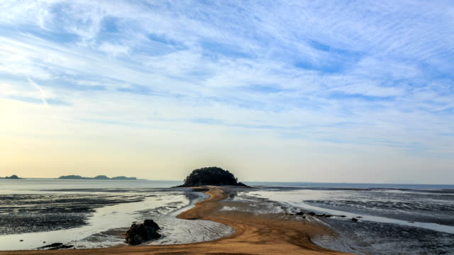 landscape of mokseom(natural landmark) in seonjaedo island at low tide - natural landmark stock videos & royalty-free footage