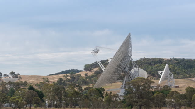 landscape of moving nasa's wide radio telescope on the field in canberra, australia - nasa video stock e b–roll
