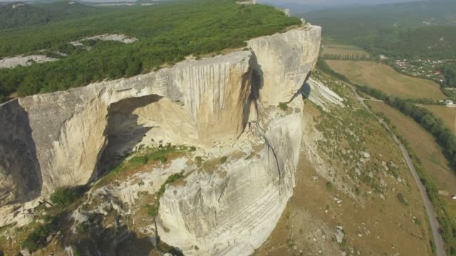 AERIAL: Landscape of plateau in rugged mountains