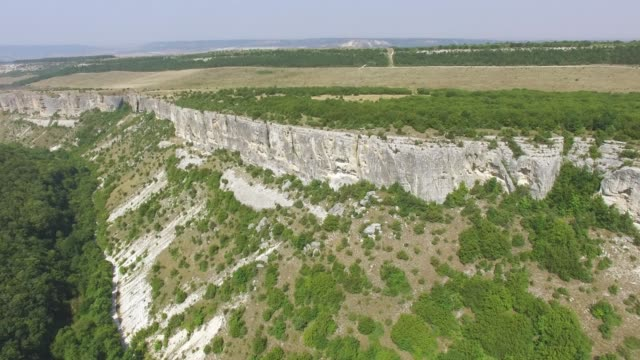 AERIAL: Landscape of plateau on rugged mountains