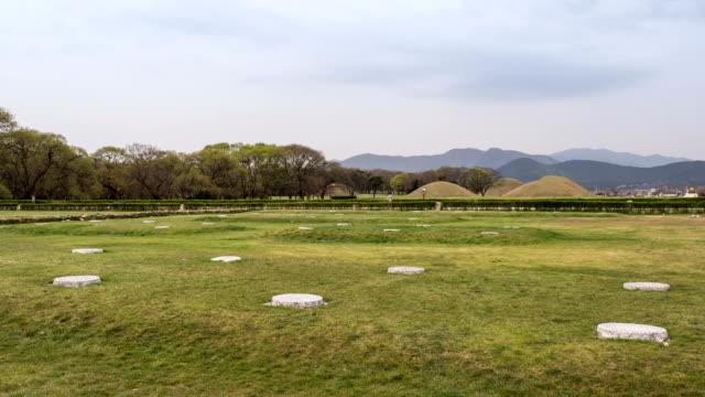 landscape of royal tomb on the green grass at banwolseong (korea historic place) in gyeongju, south korea - gyeongju stock videos & royalty-free footage
