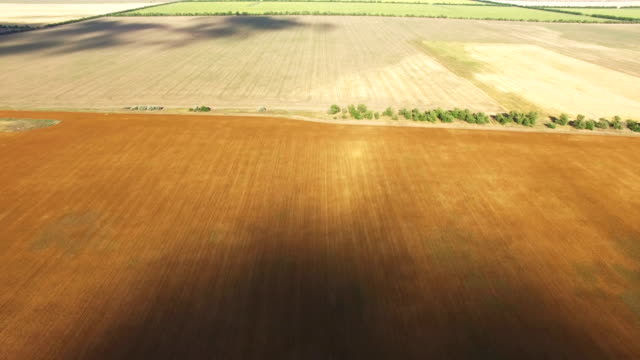 landscape of rural farmland, aerial video - chiaroscuro stock videos and b-roll footage