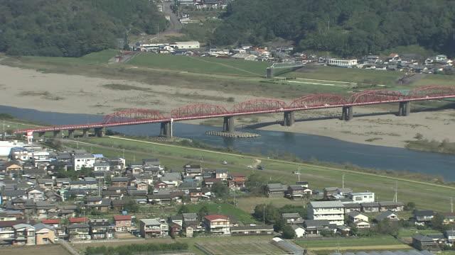landscape of shimantogawa river, kochi, japan - 農家の家点の映像素材/bロール