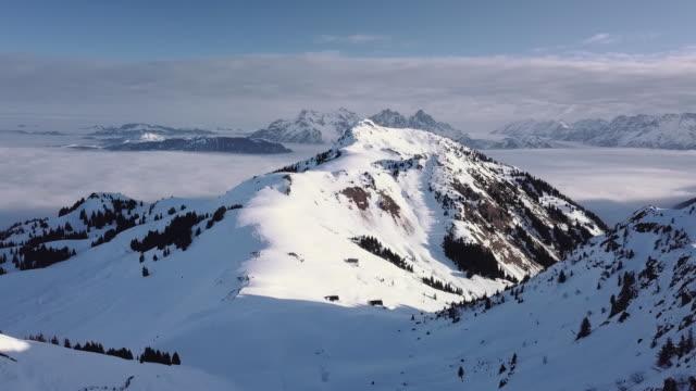 WS AERIAL Landscape of snowcapped mountain range and ski resort / Kitzbuehel, Tyrol, Austria