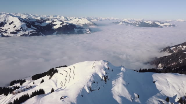 ws aerial landscape of snowcapped mountain range and ski resort / kitzbuehel, tyrol, austria - tyrol state austria stock videos and b-roll footage