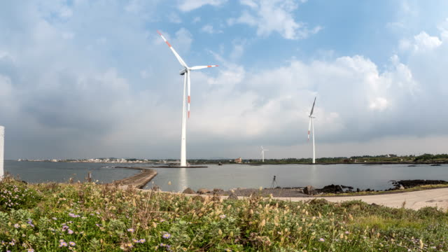 Landscape of Vertical axis wind turbine at wind power station near coastal feature