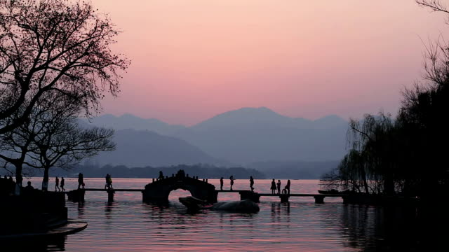 landscape of west lake in hangzhou,time lapse - hangzhou stock videos & royalty-free footage