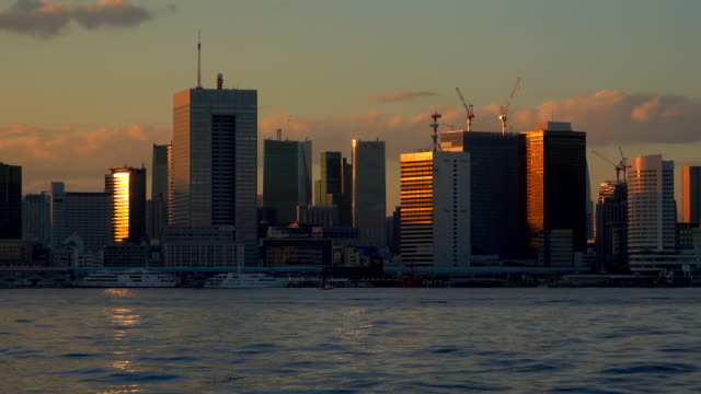 landscape seen from tokyo bay at dusk - time lapse - tokyo bay stock videos and b-roll footage