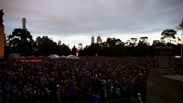 landscape shot of crowds gathering around the eternal flame. landscape shot of crowds gathering around on april 25, 2013 in various cities, australia - anzac day stock videos & royalty-free footage