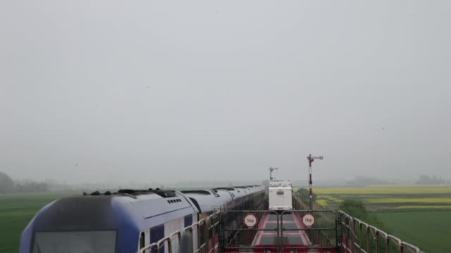 landscape shot shot from a moving train car transport train on may 18 2013 in westerland federal republic of germany - insel sylt stock-videos und b-roll-filmmaterial