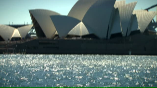 landscape shots of sydney harbour showing opera house and harbour bridge - bennelong point stock videos and b-roll footage
