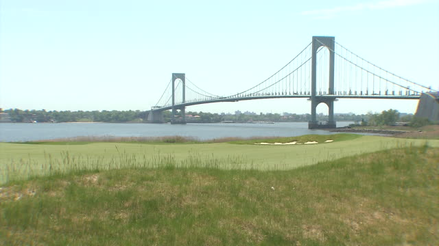 landscape shots of the trump golf links with the new york city skyline in the background wide shot views of the verrazano bridge also in the... - links golf stock videos & royalty-free footage