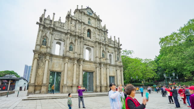 Landscape view of St. Paul Cathedral Ruins with tourists in Macau (Macao)