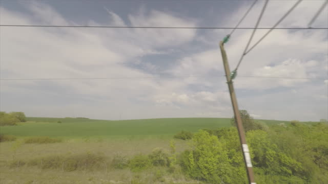 vidéos et rushes de landscape view through a train - admirer le paysage