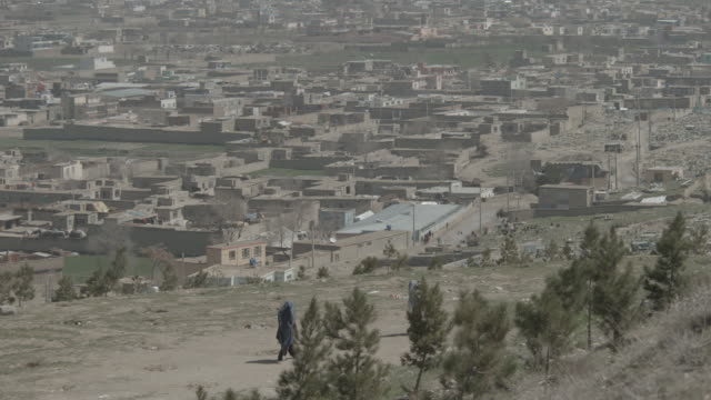 landscape, wide shot of one storey buildings at the backdrop - afghanistan stock videos & royalty-free footage