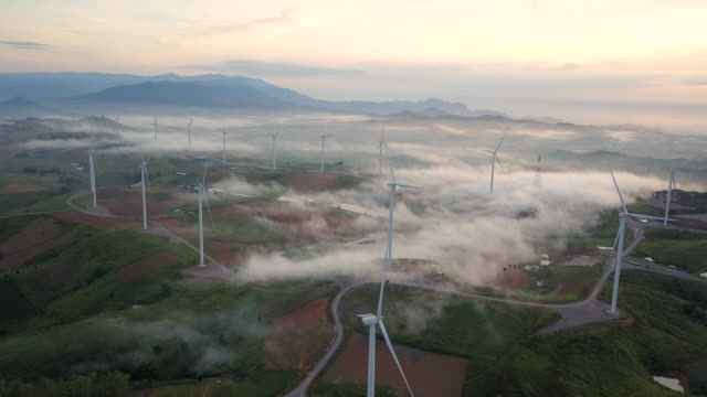 landscape wind turbine, aerial view sunrise from drone flying - turbine stock-videos und b-roll-filmmaterial