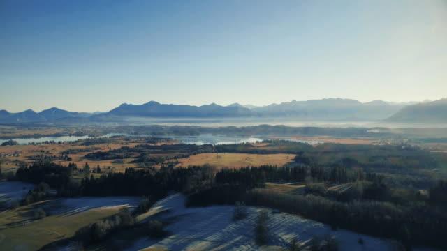 landscape with a lake at the bavarian alps - bavarian alps点の映像素材/bロール