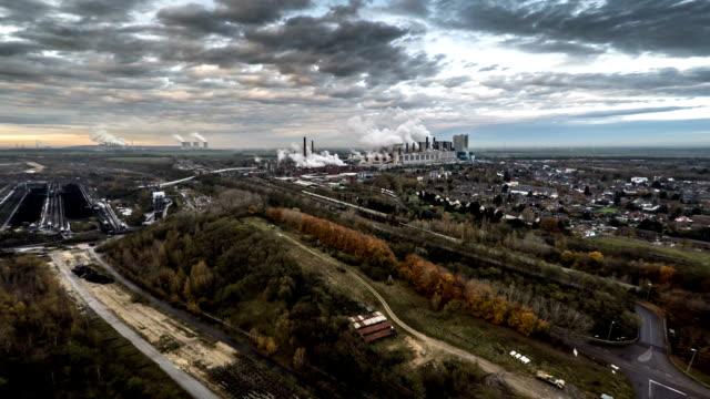 vídeos y material grabado en eventos de stock de antena: paisaje con la industria - perspectiva desde un helicóptero