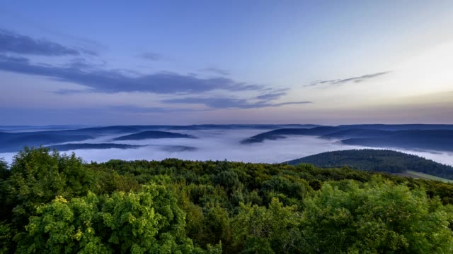 landscape with morning mist and sunrise, katzenbuckel mountain, waldbrunn, odenwald, baden-wurttemberg, germany - baden wurttemberg stock videos and b-roll footage