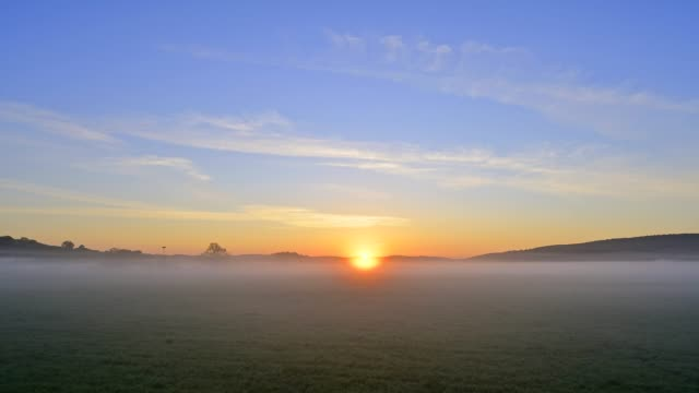 landscape with morning mist at sunrise, nature reserve, im rußland und in der kuhweide, limeshain, wetterau district, hesse, germany - horizon over land stock videos & royalty-free footage