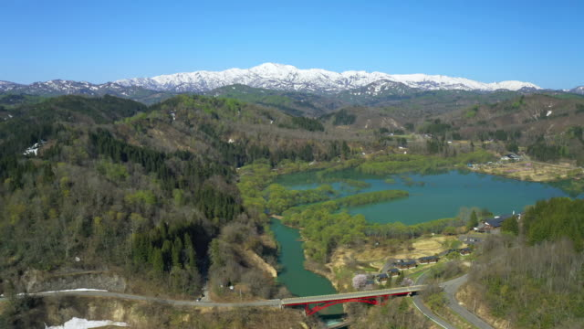 vídeos de stock e filmes b-roll de ws aerial landscape with mount iide and lake, fukushima prefecture, japan - paisagem cena não urbana