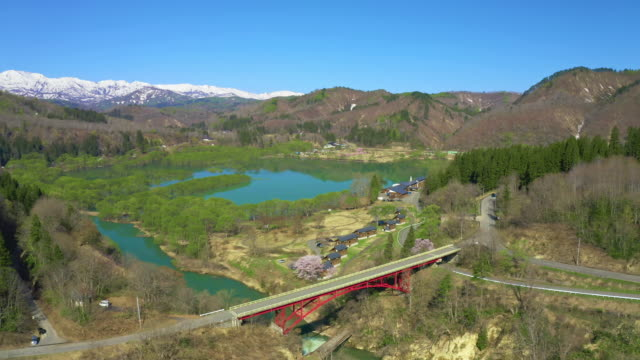 ws aerial landscape with mount iide and lake, fukushima prefecture, japan - naturwunder stock-videos und b-roll-filmmaterial