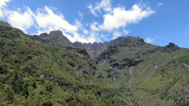 stockvideo's en b-roll-footage met ws landscape with mountains under blue sky, reunion island - french overseas territory