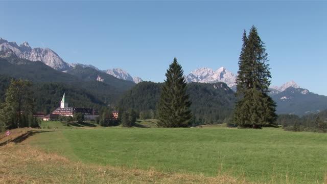 ws landscape with trees mountains fields and castle hotel / garmisch, bavaria, germany - garmisch partenkirchen stock videos and b-roll footage