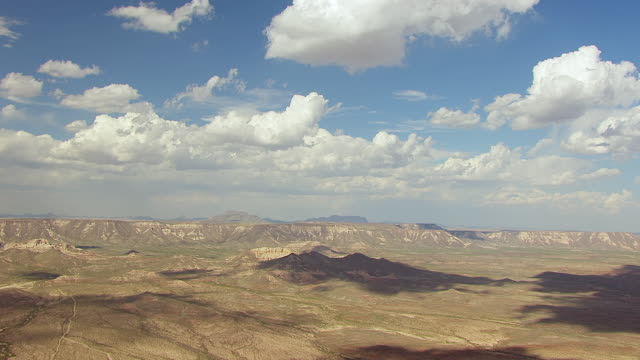 WS AERIAL Landscape with white puffy clouds in Big Bend Country in Chihuahuan Desert / Texas, United States