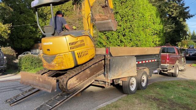landscaper driving backhoe onto his truck - landscaped stock videos & royalty-free footage