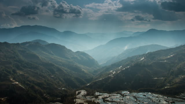 landscapes on mountain and rice terrace with ray light in china - digital composite stock videos & royalty-free footage