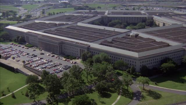 landscaping and parking lots surround the pentagon in arlington, virginia. - arlington virginia stock videos & royalty-free footage