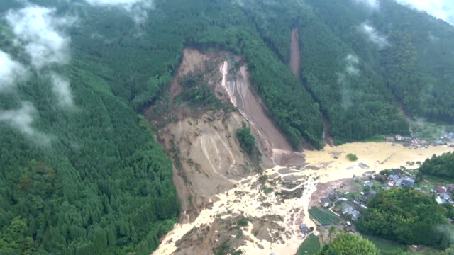 a landslide smashes into a river blocks a road and sweeps away houses in hita oita prefecture on july 6japan - oita prefecture stock videos & royalty-free footage